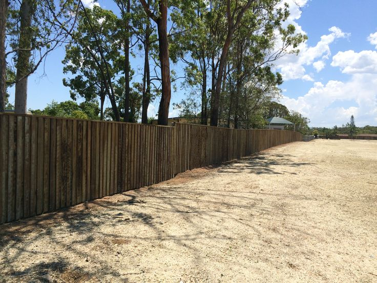 Lapped and capped hardwood timber fence