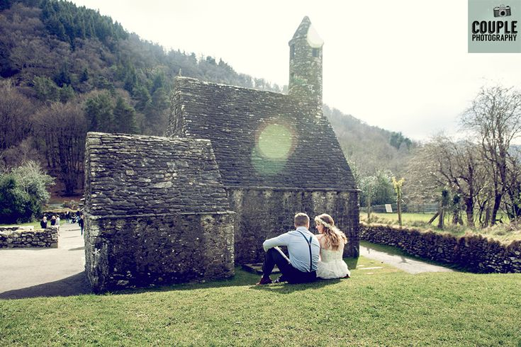 sharing a moment at the Glendalough Historic site by www.couple.ie