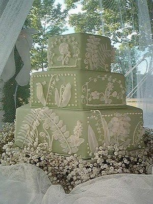 antique white and green pastel wedding cake