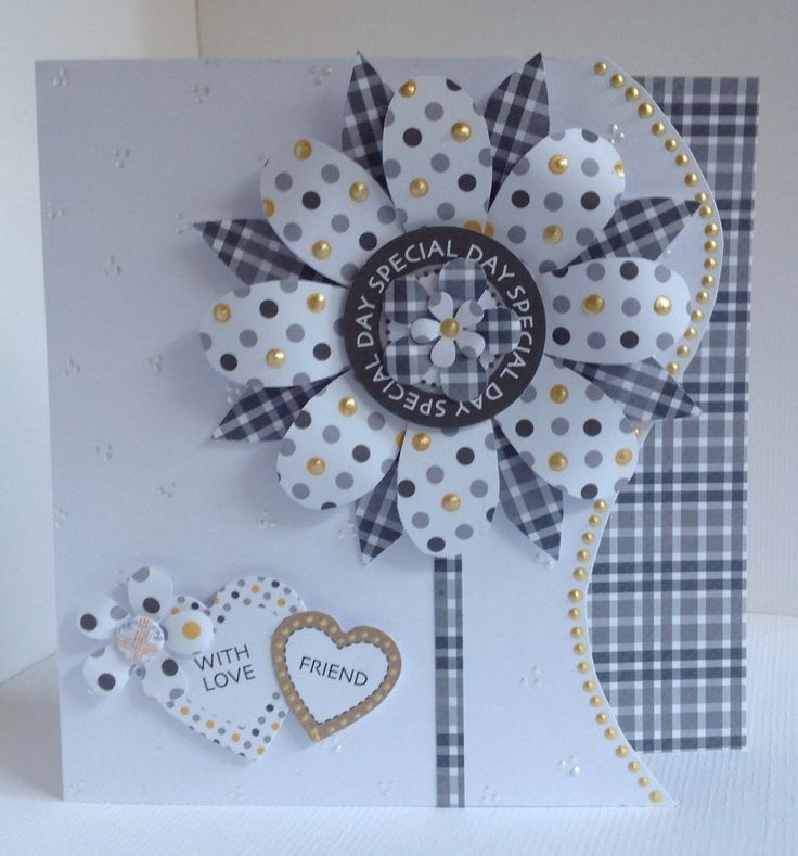 Card designed by Julie Hickey using Suits You Sir 6x6 paper pad, die cuts and template. Large flower made with papers with sentiment in centre. Edge of card cut to add interest.