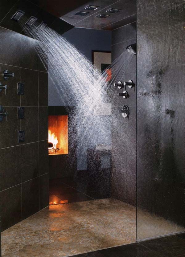 Interesting juxtaposition of fire and water, with this bathroom #fireplace. Design by Vartnya Hem