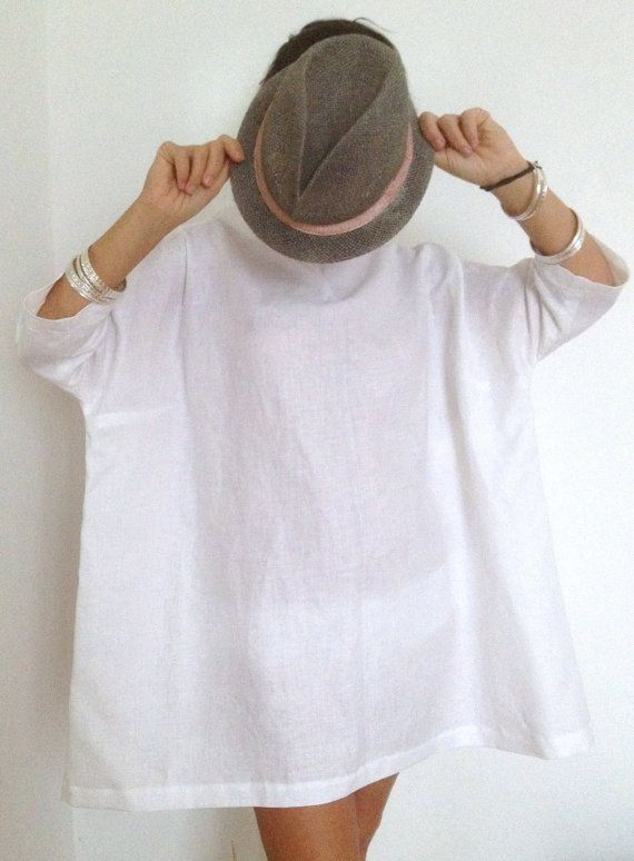 I made this linen dress using a resin linen of excellent quality .   you can wear this linen tunic naked legs or with jeans or leggings , she has a high collar that you can easily drop , and the sleeves 3/4 .  I made this white tunic thinking of curvy women and I realized that it s fine also for skinny women ( range perhaps with a belt ) .  This white oversized shirt is perfect with a casual outfit , and becomes elegant when paired with the right accessories ( silver jewelry , hats , hee...