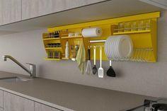 Nichos organizadores de cozinha. Organizadores de pia, como os suportes de detergente e bucha para lavar a louça? É uma boa ter na pia, pois assim você economiza o espaço do gabinete.  Fotografia: http://casa.abril.com.br