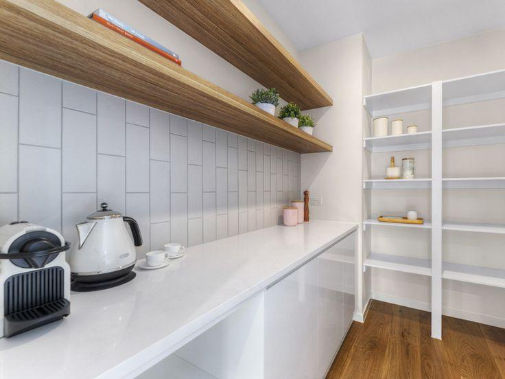 Timber shelving hidden behind kitchen doors