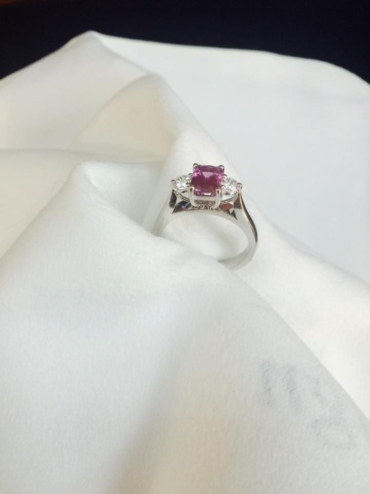 Another new addition to our Sapphire collection: This three stone ring features a radiant cut Pink Sapphire centre and round diamond sides.