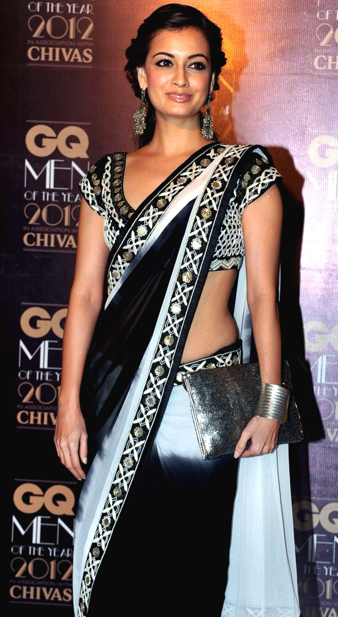 Black and white saree with mirror work on the border and the blouse