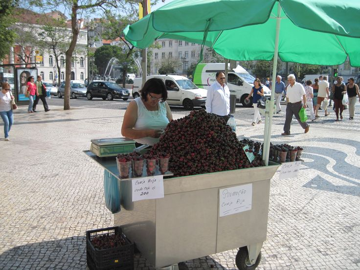 The cherry lady who sells cherries (big dark red delicious ones) in Praça de Figueiras
