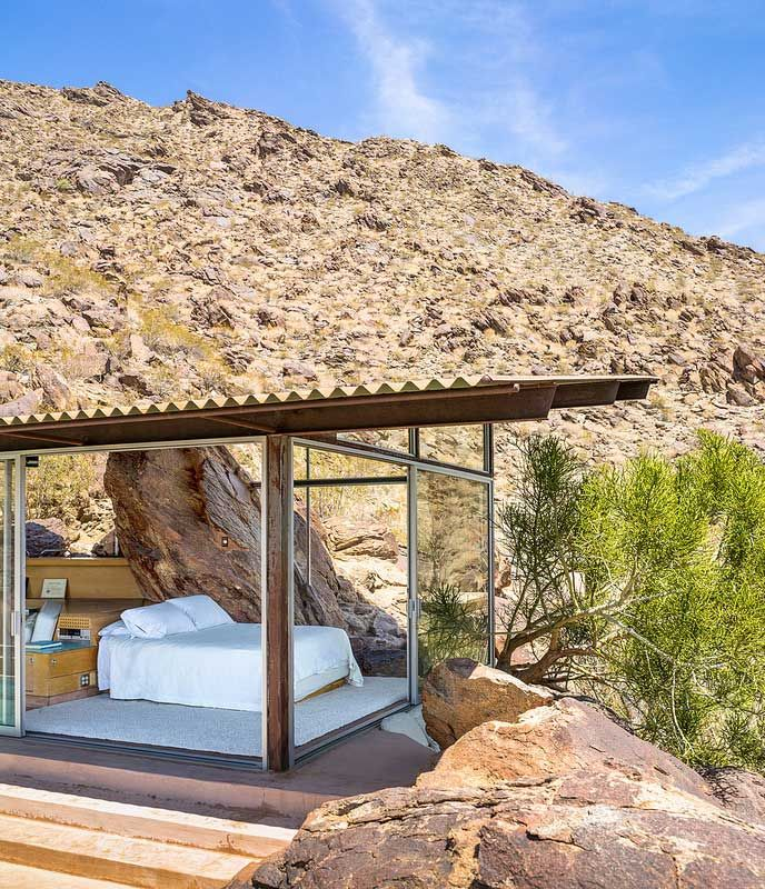 I love the idea of incorporating the elements of nature into the design of a house. Here the boulder juts up into the interior and becomes integrated with the facade. It's away of bringing the outside in and blurring the lines between indoors and outdoors. | Albert Frey's Palm Springs House Simply Disappears Into The Desert Landscape