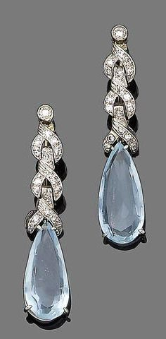 A pair of aquamarine and diamond earrings Each pear-shaped aquamarine suspended from an openwork brilliant-cut diamond surmount, diamonds approx. 0.40ct total, length 4.5cm