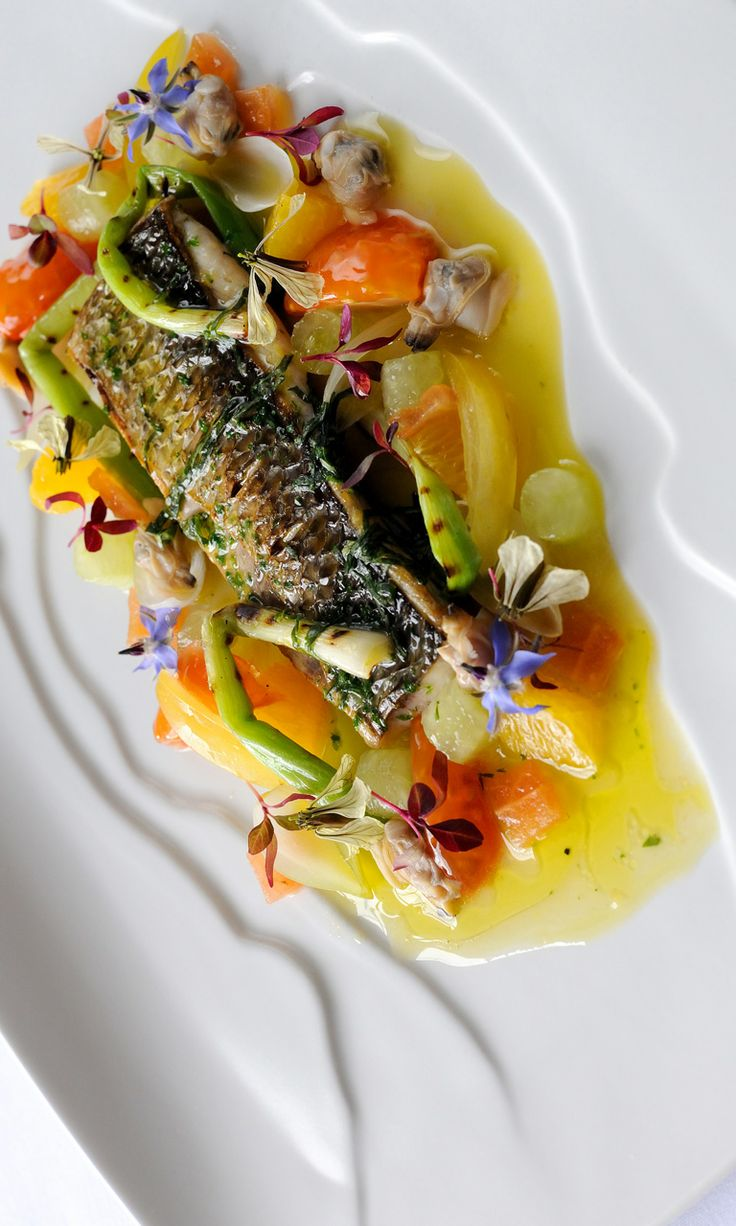 Fillet of silver mullet with grilled spring onions, cucumber, confit tomatoes and sauce vierge - Simon Hulstone. Silver mullet - which is also known as grey mullet - is a fantastic sustainable seafood option which carries a similar flavour to sea bass and remains available all year round.