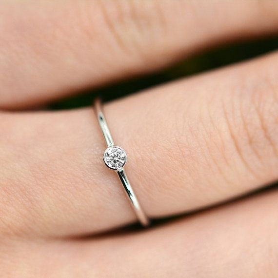 The Petite Round Diamond Ring is for the everyday, dont have to worry about matching kind of ring. We wanted something that is understated but beautiful in its own way that is comfortable to wear all the time. The genuine 0.10 ct round diamond is bezel set in a round edge solid 14K gold
