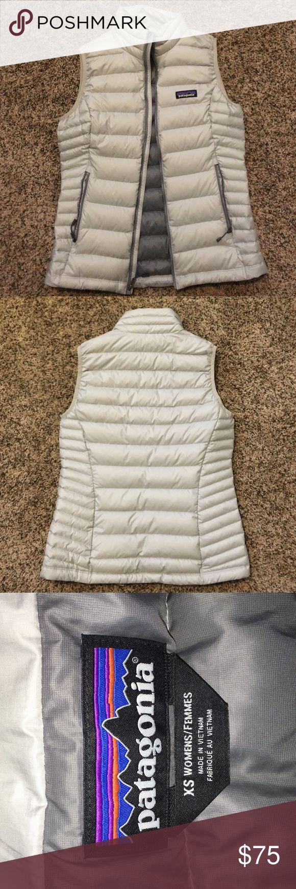 Patagonia down sweater vest Silvery/white women's xs. This was worn once because it was too small and I did not save the gift receipt. Open to trades for a bigger size! Patagonia Jackets & Coats Vests
