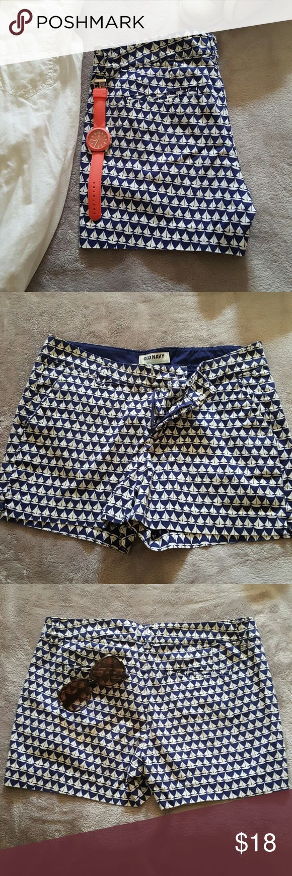 "Sailboat Print Shorts | Like New These don't fit me anymore and I LOVE them!   * In excellent condition- no signs of wear.   Sailboat print on these is adorable!  *2 angled front pockets,  2 back pockets (back pockets are not as deep as front pockets)  * Tab front closure with button for secure close, and zipper.  *Vents on side of shorts keep the legs laying straight- not that wierd winged look. *Waist:  15.25""; 3"" inseam *98% Cotton;  2% Spandex-Machine Washable Old Navy Shorts"