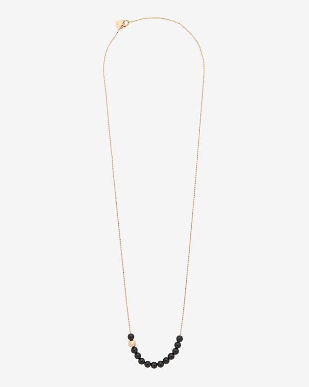 Ginette NY Onyx Strand Necklace: 12 onyx stones and a single rose-gold bead accent this 18 necklace. Ring clasp closure. In 18K ...