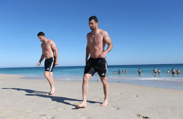 Rob Kearney (R) and Alex Cuthbert walk out of the ocean during the British and Irish Lions training session held at Langley Park on June 3, 2013 in Perth, Western Australia.