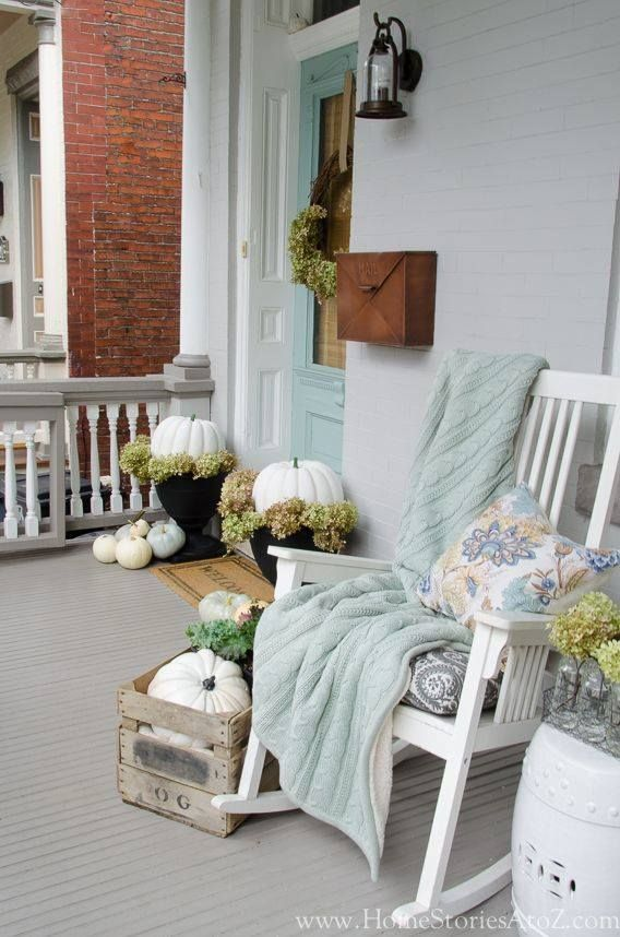 Soft blue & white fall harvest decor with pumpkins on wood plank floor porch...romantic rustic traditional decorating...The Good Witch inspired