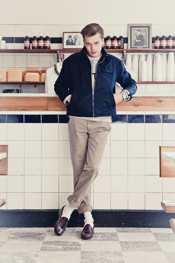 Ivy style: blue harrington jacket, white crewneck, rolled khaki chinos, brown tassel loafers