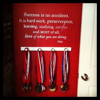 Such a neat way to display all those soccer [or any!] medals. #wallquotes