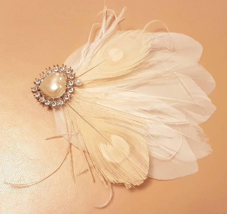 Excited to share the latest addition to my #etsy shop: Bridal Hair Clip Bridal Feather Fascinator, Feather Hair Piece, Wedding Hair Accessory, ivory feather hair clip, Bridal feather fascinator http://etsy.me/2D0hwxe #weddings #accessories #white #hairaccessories #