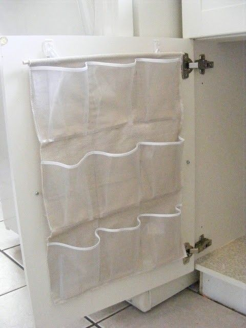 Shoe organizer cut to fit cabinet door-Great idea for bathroom or under kitchen sink! **I'm doing this for the pantry cabinets to store packets, rices and beans, and any other stray items