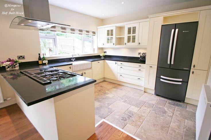 Eastbourne : Large English country kitchen with black granite worktop, island cooking area, cream shaker doors, double Belfast sink, American fridge freezer and roman blind