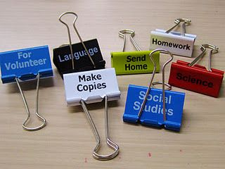 Write on the clips with Sharpie or print on small slips of paper and tape it to them.