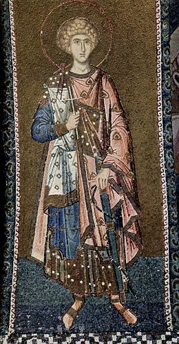 The following art is a picture of a, 14th century military martyr wearing four layers, all patterned with a richly trimmed attached with a cloak and tablion over a short dalmatic, with another layer including a tunic.
