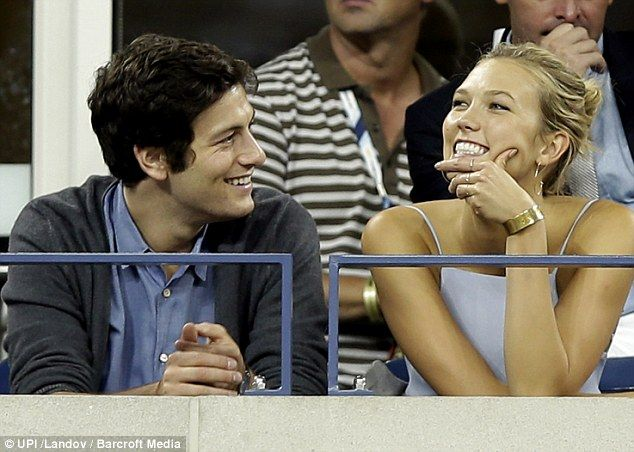 Something to smile about: The pair seemed to be having a lively conversation as they enjoyed the match