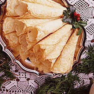 Whipped Cream Krumkake Recipe. I grew up on these! Fill with whipped cream and berries...