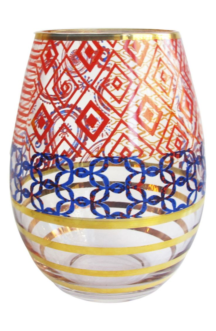 How fun are these stemless wine glasses with a mix of geometric patterns in bright colors for a festive look?