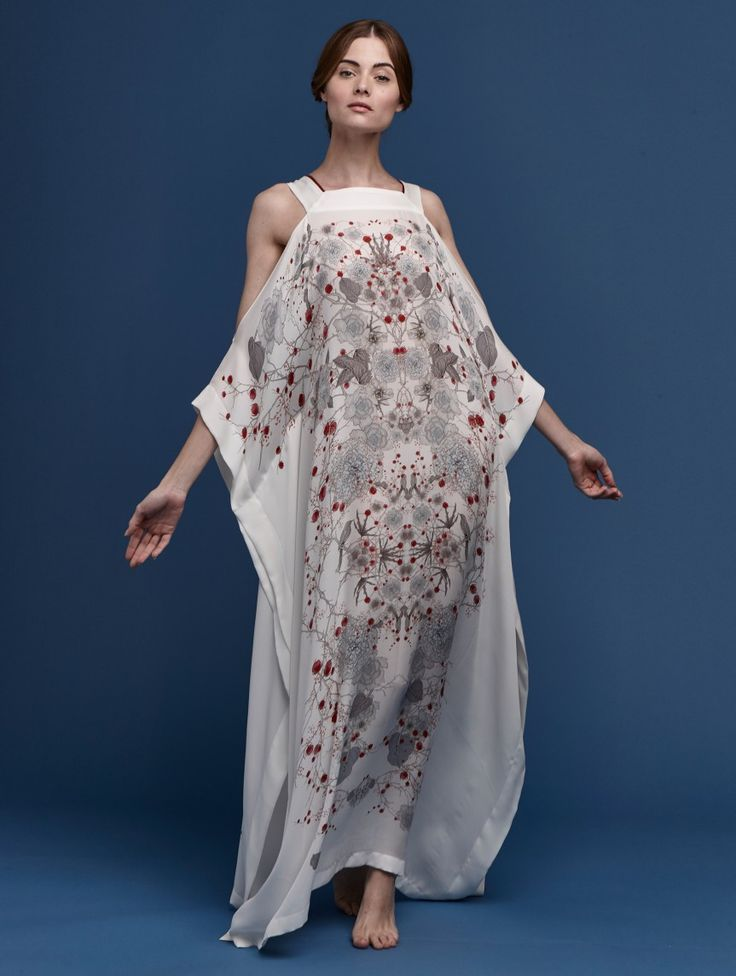 PRINTED OPEN SHOULDER SILK KAFTAN WHITE RED CHERRY BLOSSOM  Soft red blooms and delicate foliage adorn this beautiful kaftan. With a blue-grey silk and symmetrical print, this loungewear piece evokes a sense of tranquility and splendor. Enjoy printed open shoulder silk kaftan white red cherry blossom.
