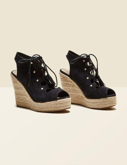 sandales compensées pompons noires