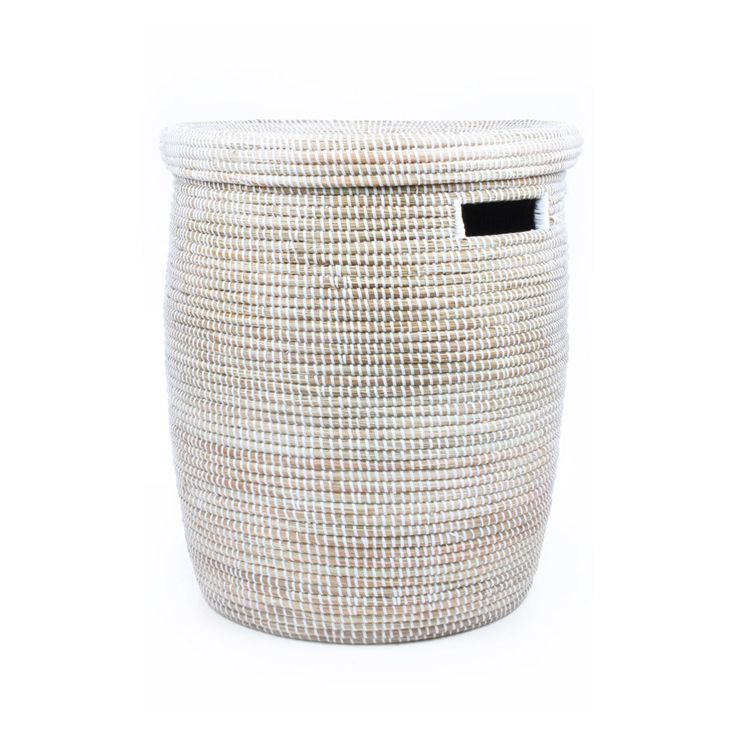 White Woven Laundry Basket. Simple beauty. Let your laundry sit pretty in this white woven laundry basket. Each basket is handwoven in Africa and comes with a lid that fits snugly inside the basket. Perfect for storing laundry, children's toys, bathroom linens, or any place that needs some extra storage space.