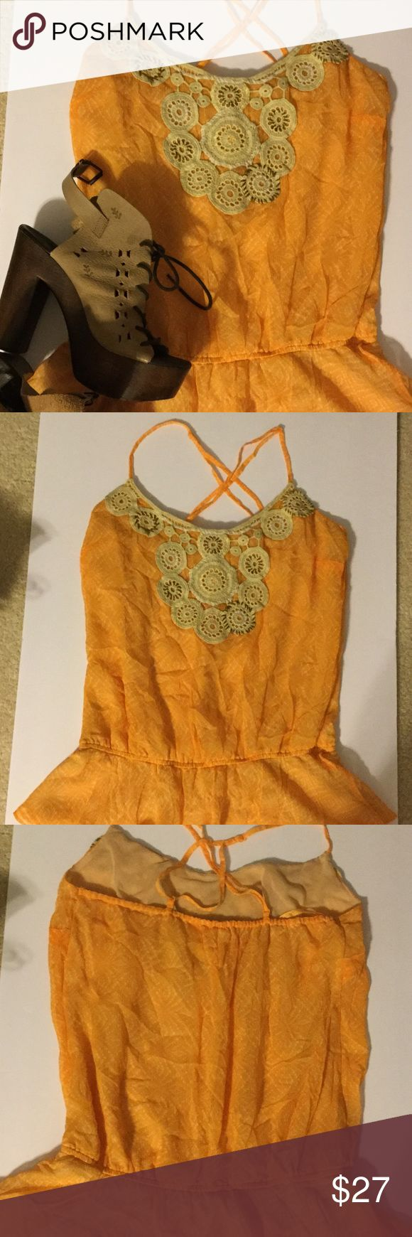 Free People crochet top SALE THIS WEEKEND ONLY 👗 Free People orange patterned top with crochet detail at the neck as shown in last picture. This top has adjustable spaghetti straps. This top is dry clean only. The top is approx 25 inches from top of strap to bottom of hem. Free People Tops Blouses