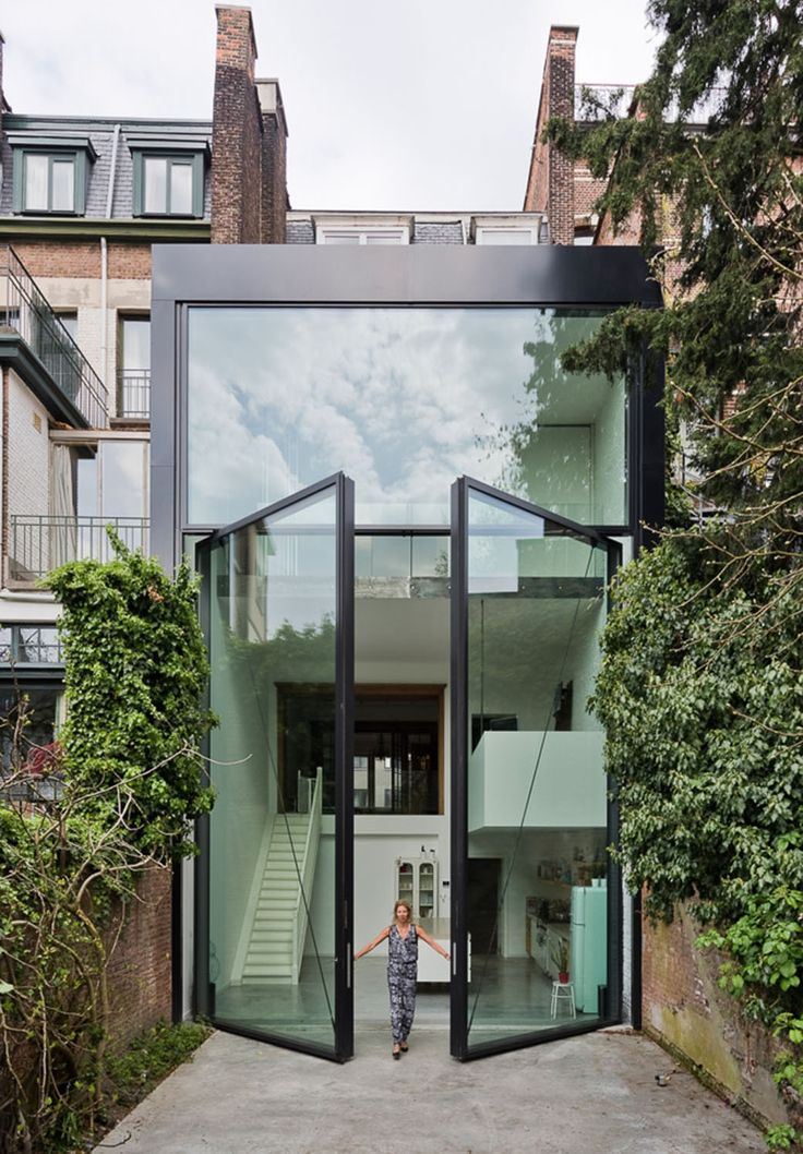 Over The Top Entry Opening The Entire Space To Create An Instant  Indoor/outdoor Feeling. Antwerp Town House By Sculp(IT) Features Worldu0027s  Largest Pivoting ...