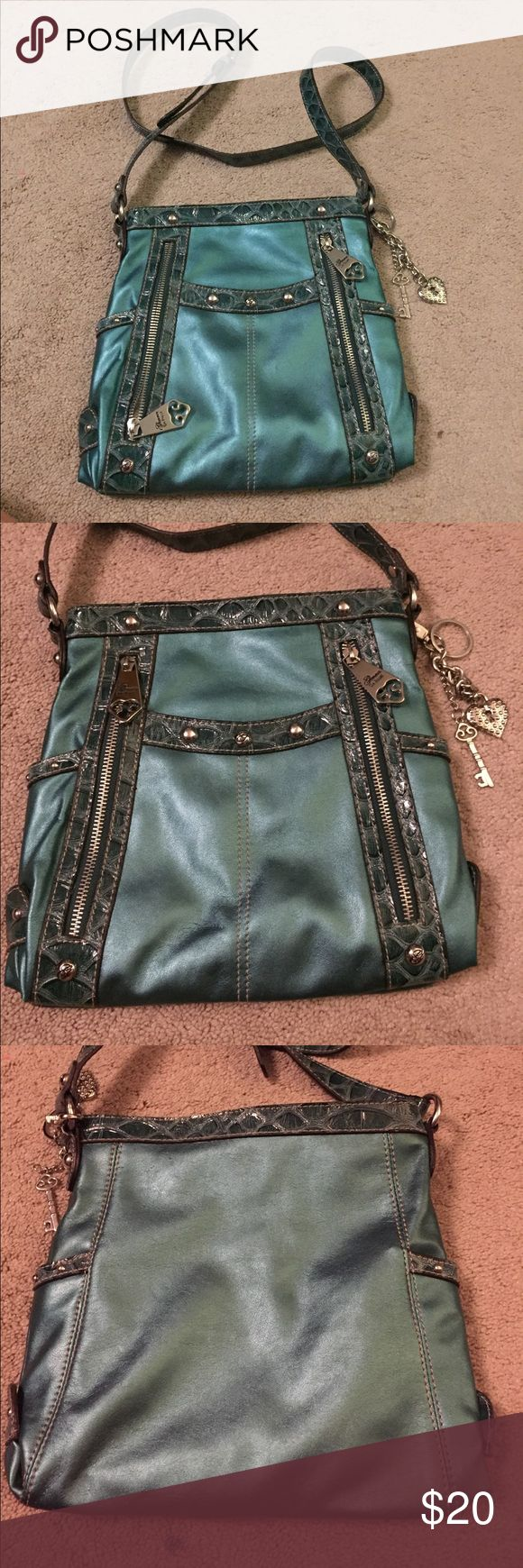 Genna de Rossi Teal Purse with Long Strap Beautiful Teal purse with long strap. Two front zipper pockets. Two side pockets. Front middle pocket. Two charms with key and heart. Genna De Rossi Bags Crossbody Bags