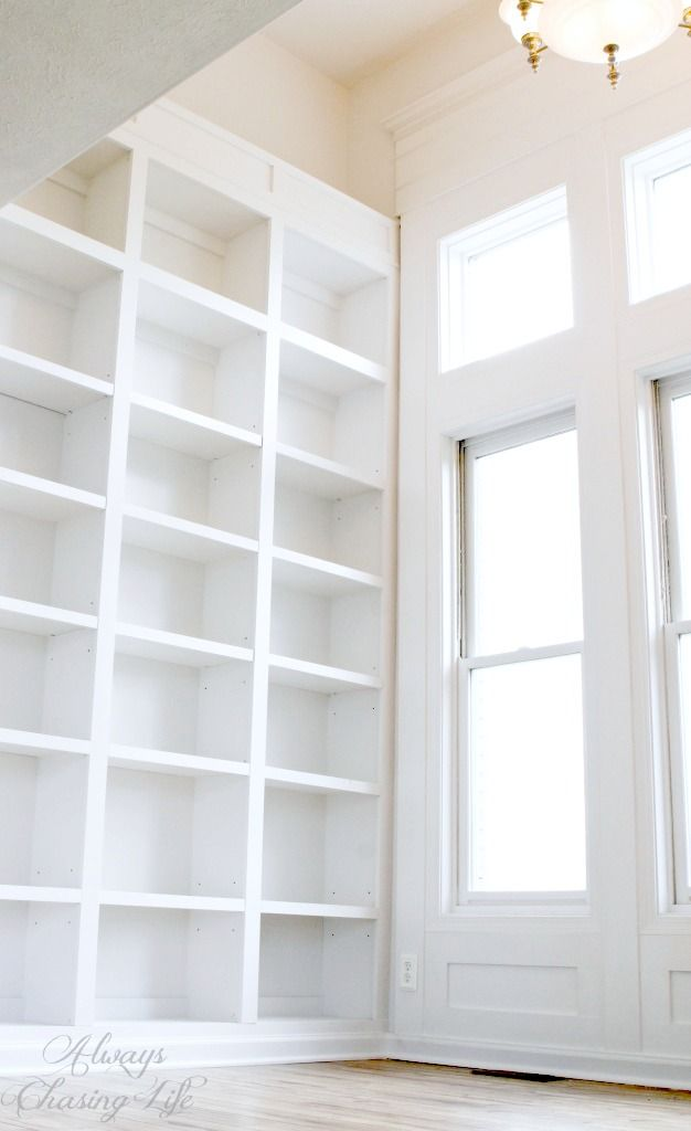 Super tall, built-in bookshelves and window wall trim.