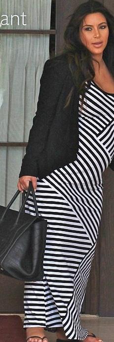 Stripe maxi dress and black tote handbag