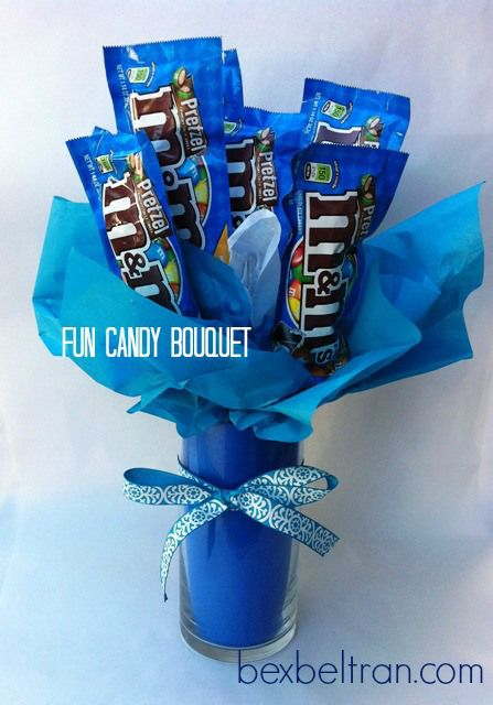 DIY candy bouquet at bexbeltran.com i bet i can diy this. But adding money in between the candies ;)