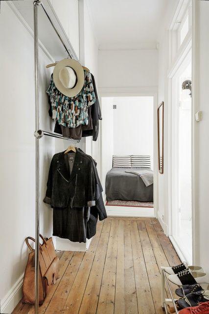 clothing racks in hallway