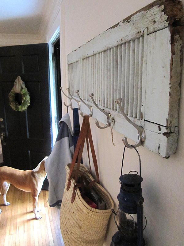 12 Creative DIY Coat Racks- Tutorials, including one for this old shutter coat rack from Charlotte Cottage.