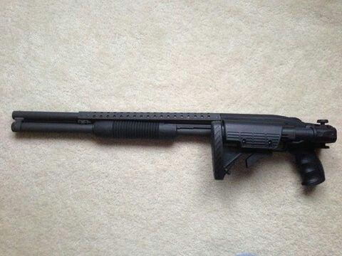 Mossberg 590 Tactical Folding Stock Pump Action Shotgun with Barrel Shroud