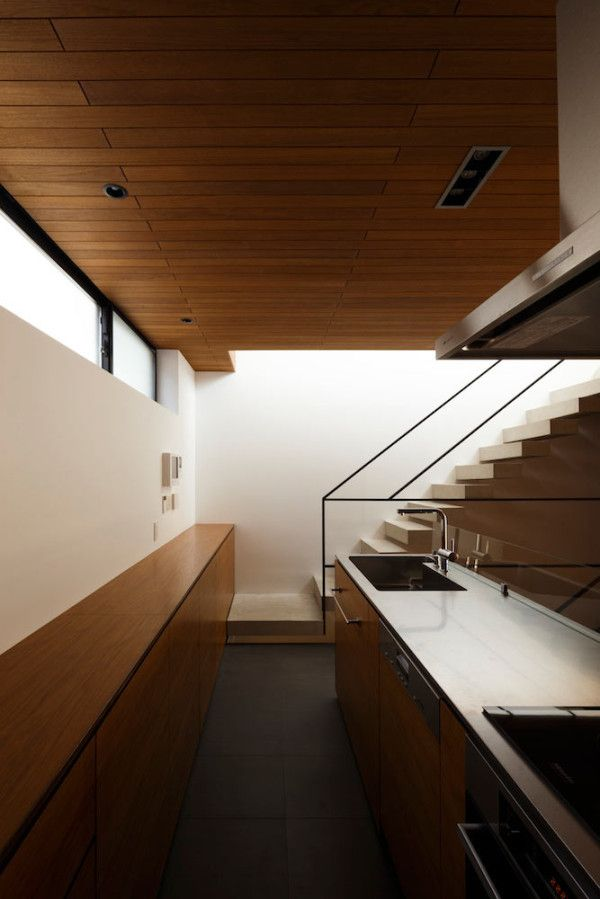 a house built with exposed concrete to reduce costs associates frame038
