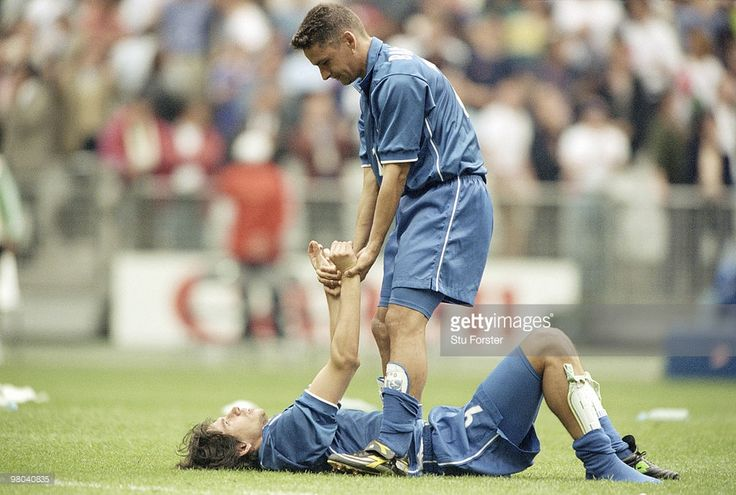 Roberto Baggio of Italy helps console his team mate Demetrio Albertini after losing in their Quarter Final match against France in a penalty shootout at the 1998 FIFA World Cup on 3 July 1998 at the Stade de France Stadium in St.Denis, Paris, France. France won 4-3 in a penalty shootout.