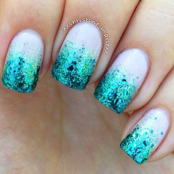 A white base coat with a blue sparkly coat at the top that slowly fades into the white.