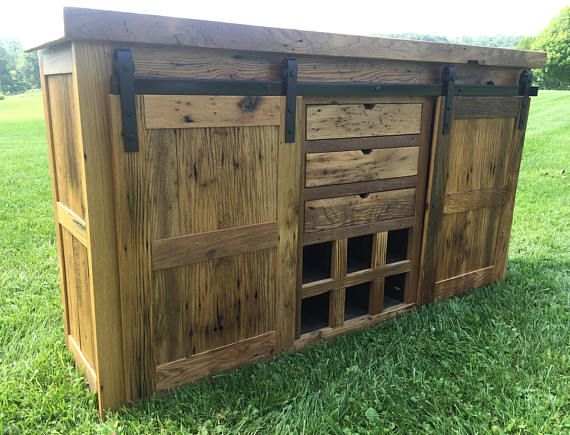 THIS BUFFET IS COMPLETED IN INVENTORY & READY TO SHIP  This buffet is hand crafted from 100-200 year old reclaimed wormy chestnut barnwood. Solid hardwood face frame, top, inlayed sides, barn doors, & dovetail drawers. Soft close drawer slides & high end barn door hardware included.