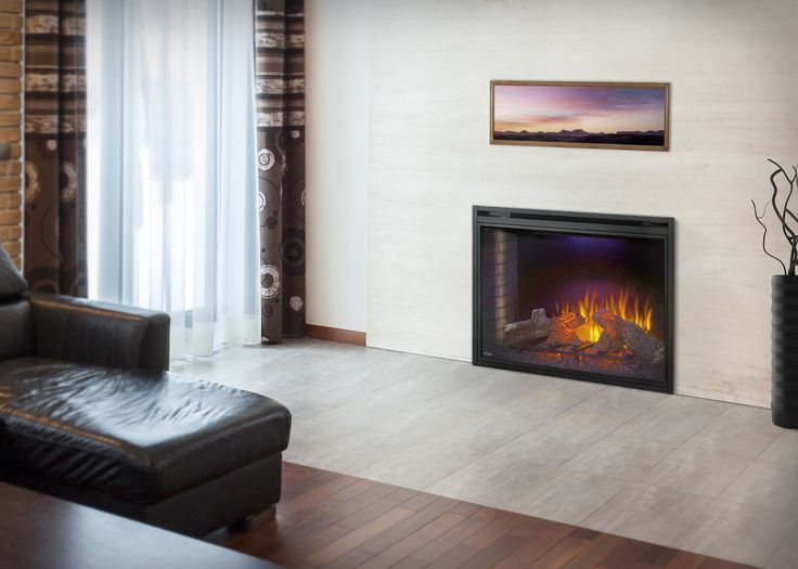The Napoleon Ascent™ 40 Electric Fireplace imitates the look of a traditional masonry fireplace but with all the convenience of simply plugging it in, sitting back and enjoying the heat and glowing log set!