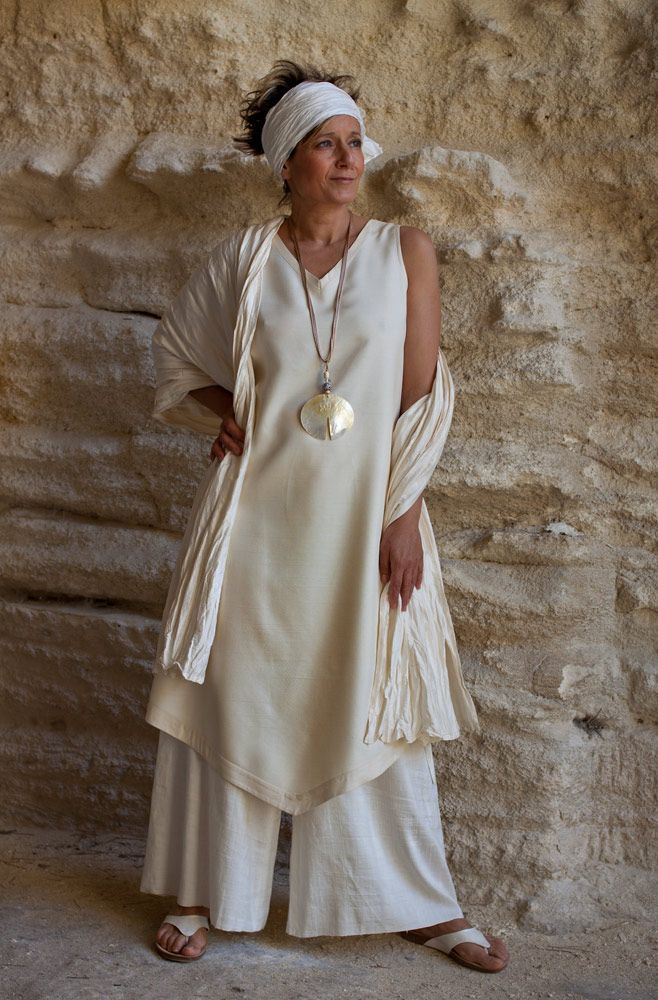 Beautifully elegant shantung outfit:  Large flowing pants in natural color worn with a high quality pearly shantung silk tunic.  Pearly thick taffeta shawl.  Thin silk scarf wrapped around the hair.  Necklace: mother of pearl and glass bead on silky cordshttp://www.amalthee-creations.com/pearly-shantung-outfit.3296
