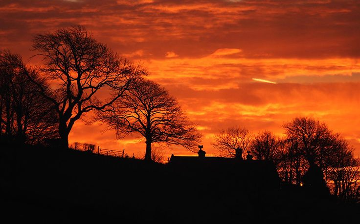 Deep shades of orange and red appear in skies over Shepton Mallet, Somerset