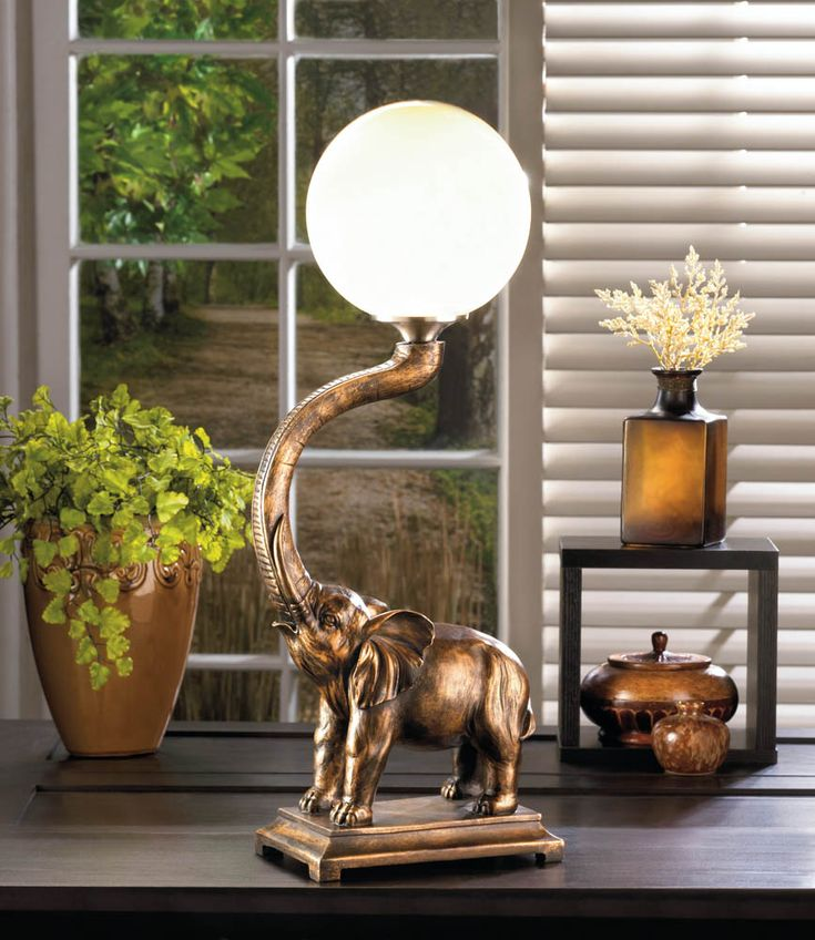 10017184+TRUMPETING+ELEPHANT+GLOBE+LAMP. This trumpeting elephant will add charm to your decor while illuminating your living space.